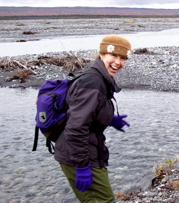 Felt hat fiber artist, Carrie Cahill Mulligan dances wildly on the banks of the McKinley River, hoping to fend off hypothermia while hiking in Denali National Park, Alaska, in early September, 2002.