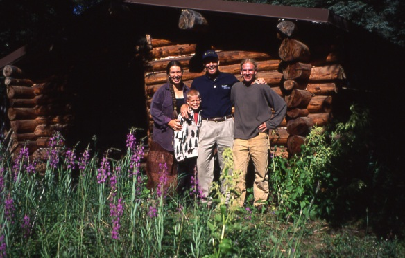 In front of our little cabin, with my brother Tim, nephew Chad, and sweet husband, Andy.