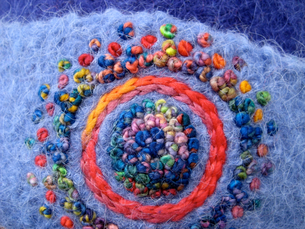 Icy-hot french-knots (more than 150!) make up the bulk of this freehand embroidery.