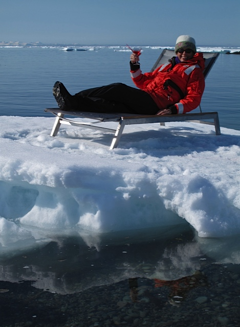Elise Lockton takes a break from searching for polar bears in Iceland, sipping a cosmopolitan while lounging on an iceberg in her Carrie Cahill Mulligan embroidered felt hat.