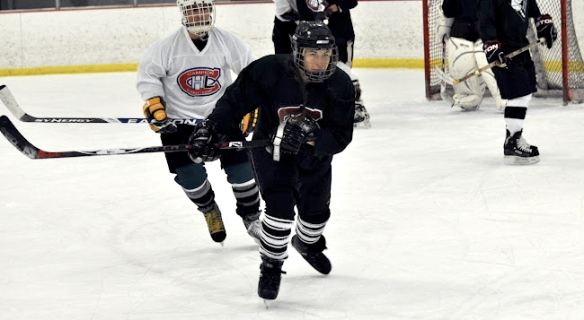 Carrie Cahill Mulligan skates hard after the puck in a Campion Hockey League game, Lebanon, New Hampshire, 2011.