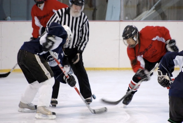 Carrie Cahill Mulligan winning the face-off during a women's hockey tournament in Stowe, Vermont, 2012.