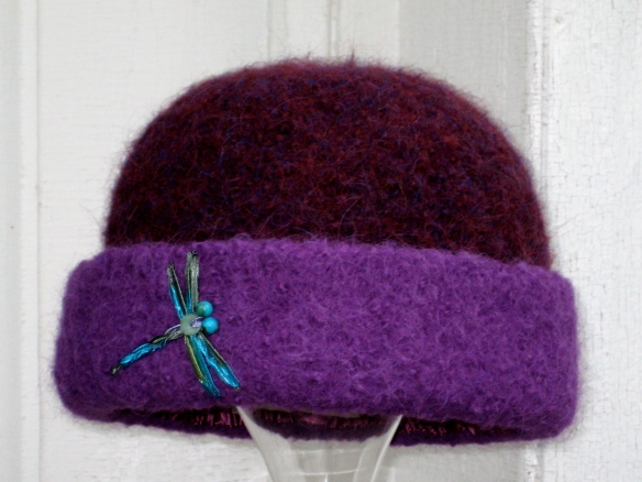 Carrie Cahill Mulligan's knitted felt hat #20 of 2012, purple with turquoise dragonfly ribbon embroidery.