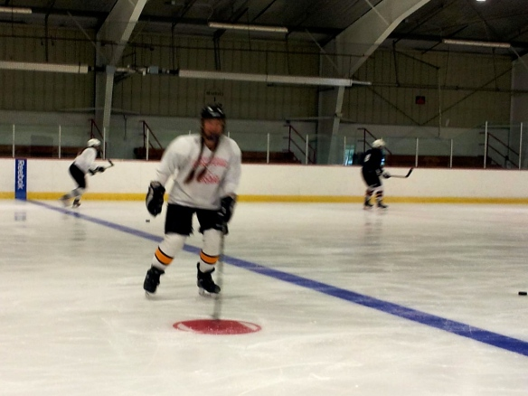 Carrie Cahill Mulligan retakes the ice at hockey boot camp just 3 days after removing her short-arm cast.