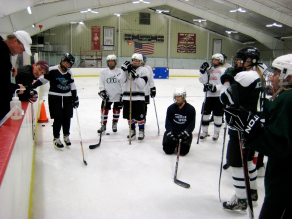 Coach Dick Dodds explains an on-ice hockey drill for the Learn-to-Play group at Campion Rink, NH