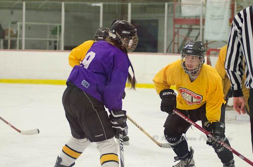 Carrie Cahill Mulligan of team Deep Purple squares off against Rob Callow of the Screaming Eagles, Campion Hockey League (CHL), Lebanon, New Hampshire.