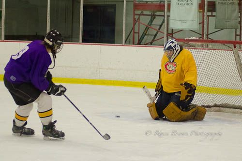 Carrie Cahill Mulligan of team Deep Purple rushes the net to support the puck in the 2013 Campion Hockey League, near Hanover, New Hampshire.