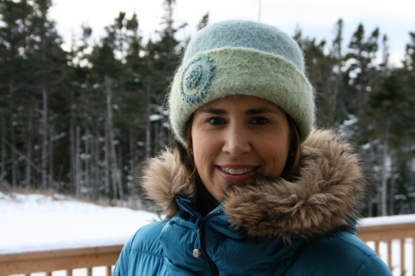 Melissa rocks her new felt hat in Newfoundland, with a matching teal parka.