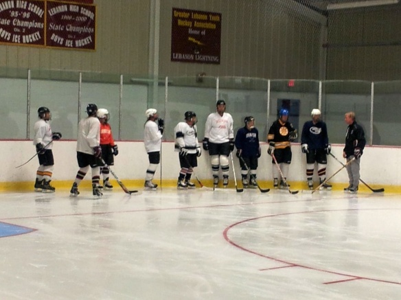 Coach Dodds explains a drill to Learn-to-Play adults at Campion Rink, Lebanon, New Hampshire.