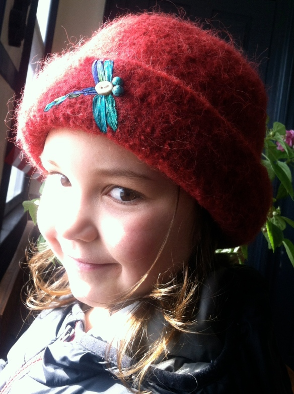Harper models her prized dragonfly felt hat.