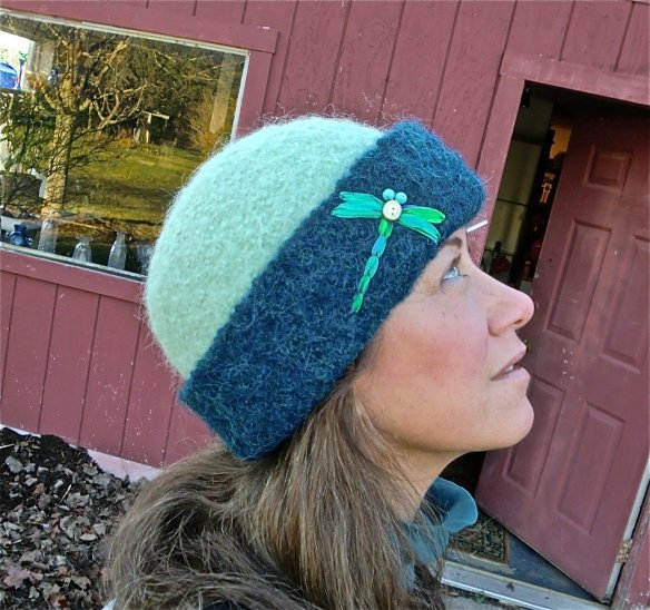 Vermont glass artist, Wendy Besett wearing her latest CCM felt hat with dragonfly embroidery.