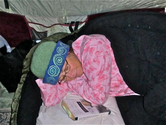 Glass artist, Wendy Besett of Hardwick, VT, camped out asleep at a fall craft show in her CCM felt hat.