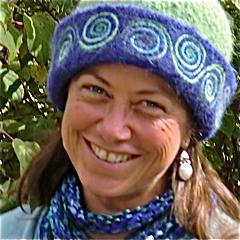 Vermont Glass Artist, Wendy Besett sports a CCM felt hat with Spiral Vine embroidery.