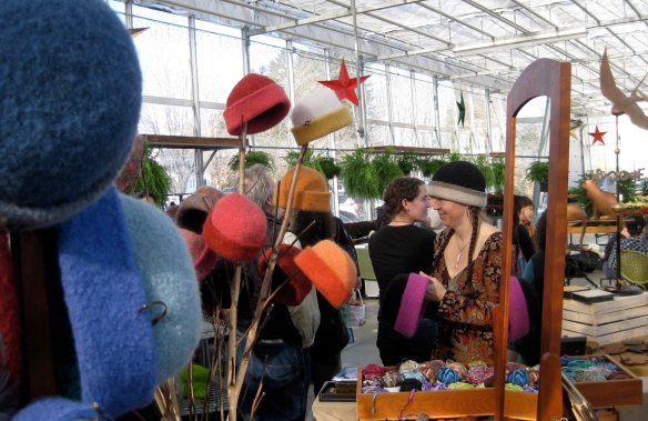 Such great lighting in the new greenhouse... really shows off the hats!