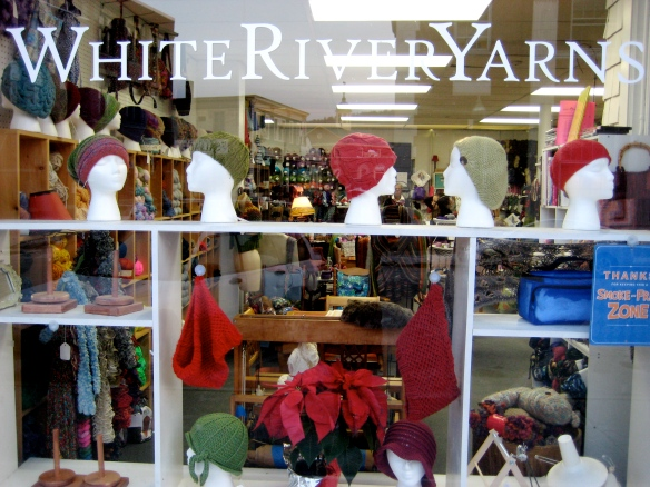 Store front window of Karen Caple's cozy local yarn shop in White River Junction, Vermont.