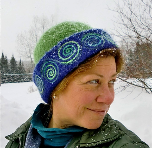 Vermont glass artist, Wendy Besett, caught wearing her favorite winter hat, a Carrie Cahill Mulligan original hand-knitted felt, with freehand spiral embroidery/