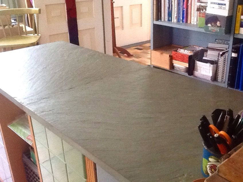 After a flurry of Spring Fever cleaning, the beautiful slate top of my office desk returns to view!