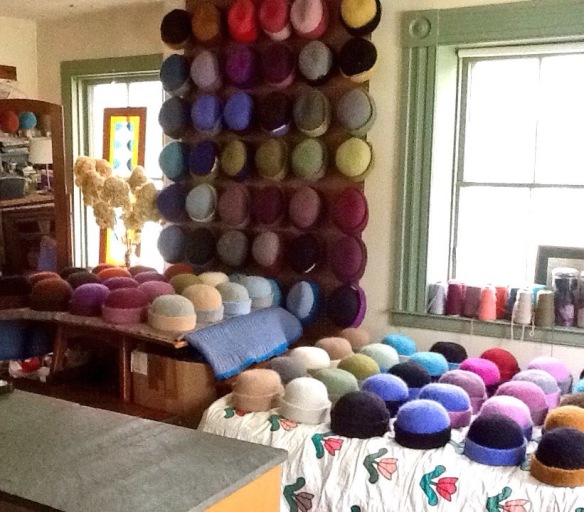 Roughly 80 felt hats line the walls and all flat surfaces in the home fiber studio of Carrie Cahill Mulligan of Canaan, New Hampshire.