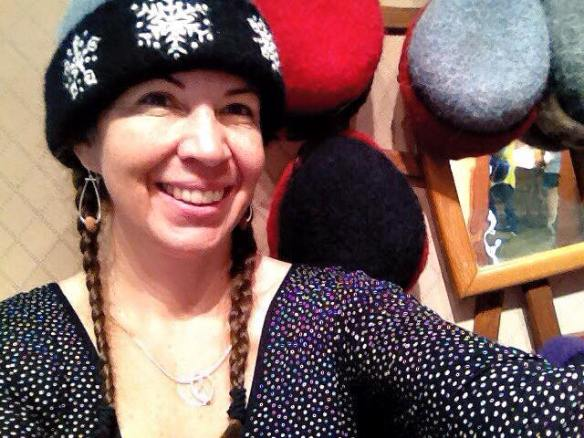 NH fiber artist, Carrie Cahill Mulligan sports one of her freehand embroidered snowflake felt hats at the 83rd LNHC Annual Fair at Mount Sunapee.