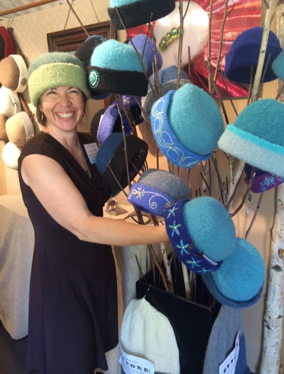 Embroidered felt hat fiber artist, Carrie Cahill Mulligan of Canaan, NH exhibits her work at the League of New Hampshire Craftsmen's summer Fair in Newbury, NH.